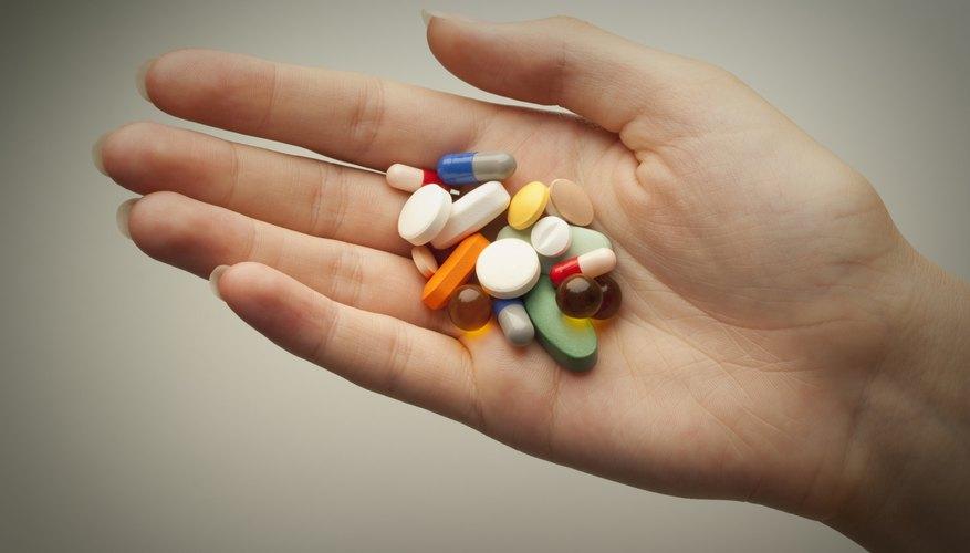 Hand full of pills.