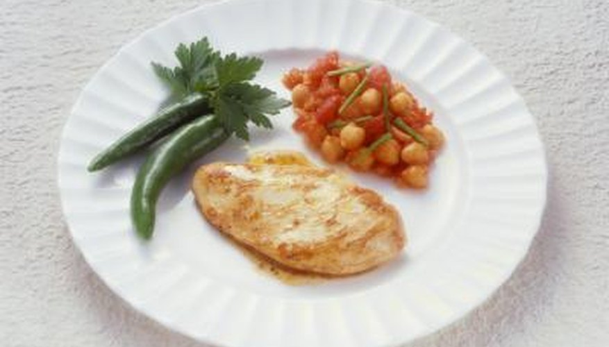 Serve baked chicken breast with a side of healthy vegetables.