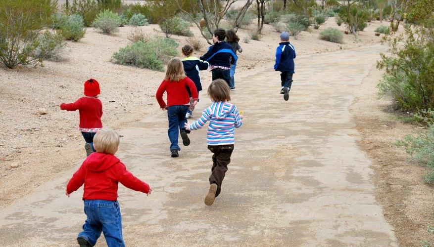 Children running down path