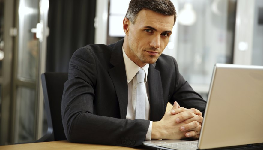 Lawyer sitting in front of laptop at desk