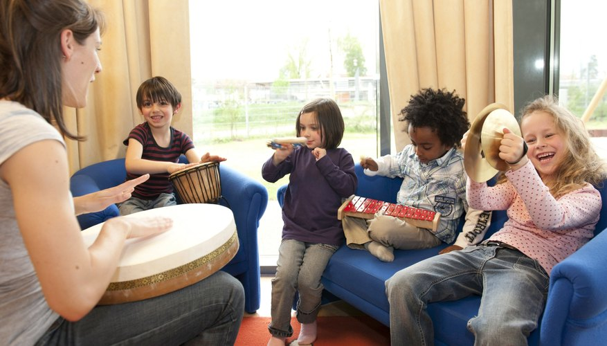 Teacher and students making music.