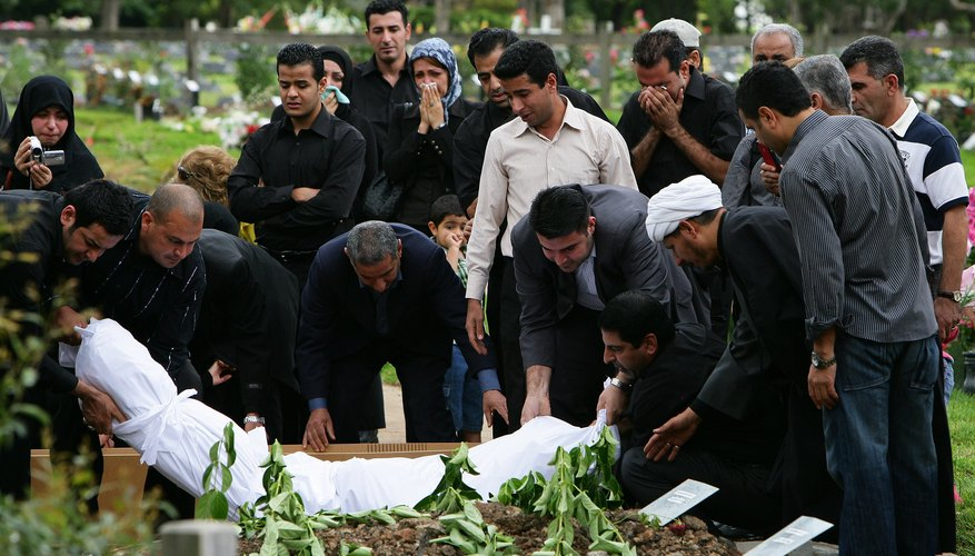 In a Muslim funeral in Australia, the deceased is buried in white cotton shroud, according to custom.