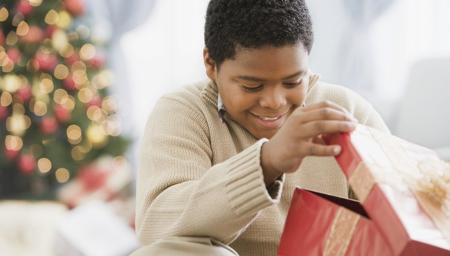 Young boy opening a Christmas present.