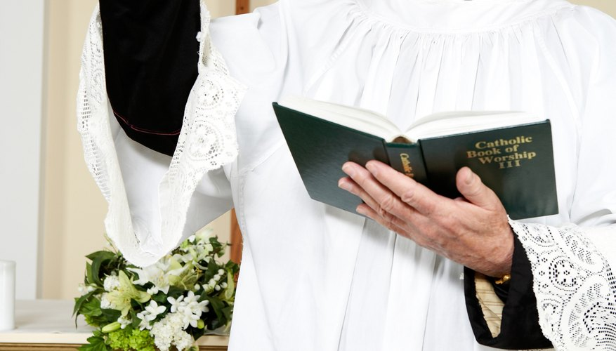 A priest follows the sacramentary from the Mass's opening prayers to its closing prayers.
