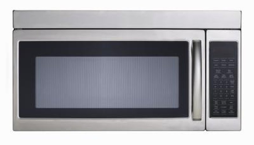 Use a metal self-etching spray primer on metallic microwaves.
