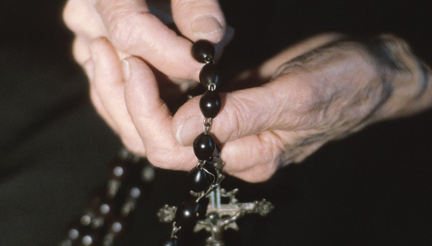 Both Anglican and Catholic rosaries contain a cross.