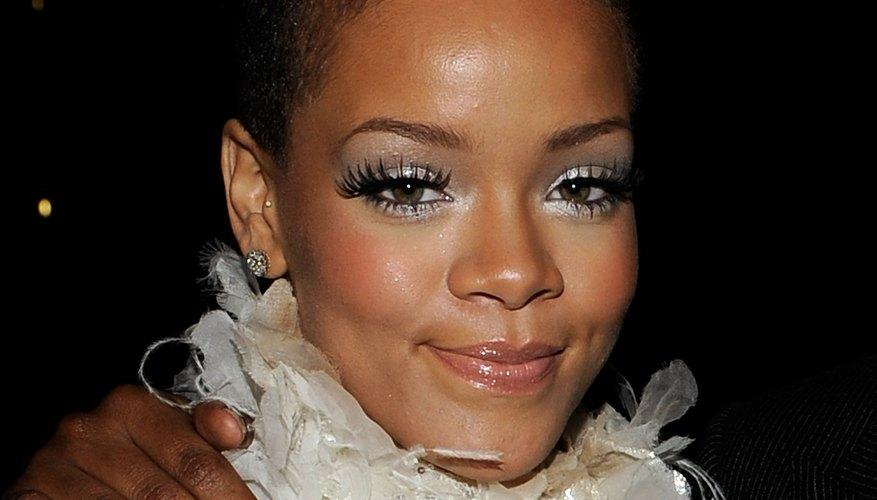 Rihanna's long mohawk allows for wavy styling that creates a feminine look.