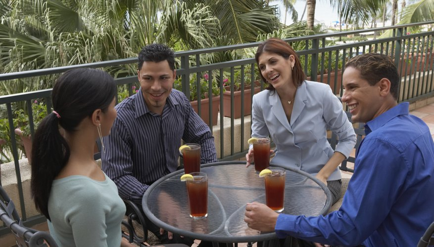 On double dates, round tables promote easy conversation among everyone.