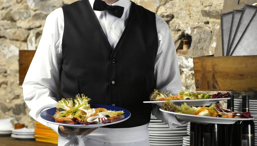 Etiquette demands that you summon a waiter as subtly as possible.