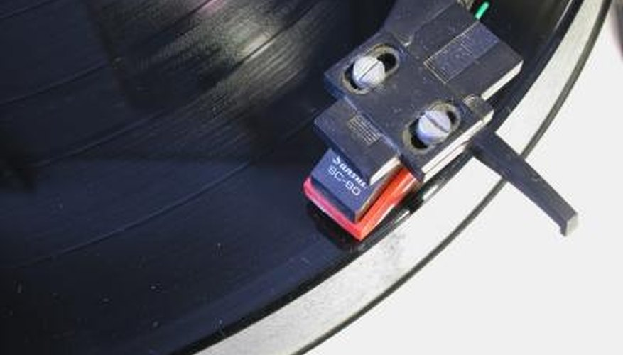 The needle that reads the grooves in a record is referred to as a stylus.