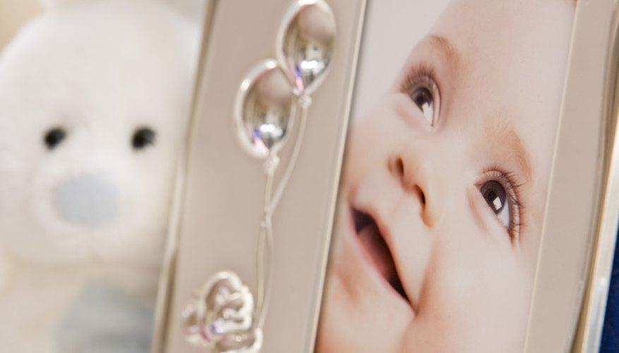 Personalized frames can be used to display a photo of the child in baptism attire