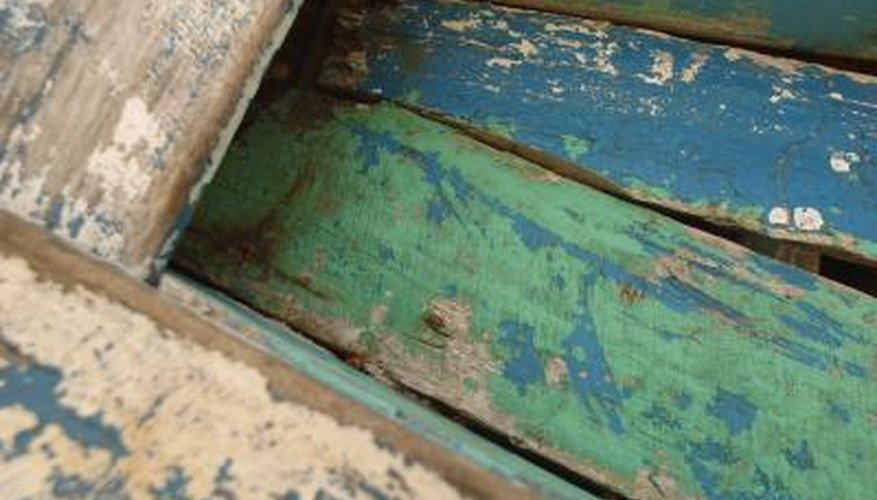 Old paint on outdoor wood surfaces chips and peels with age.