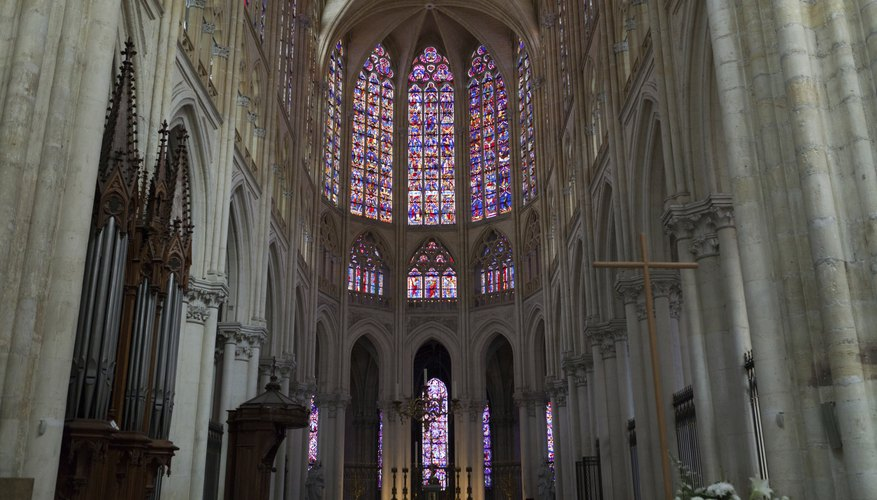 Though Gothic cathedrals allowed for larger windows, stained glass often made the interiors darker, as seen at Saint Gatien.