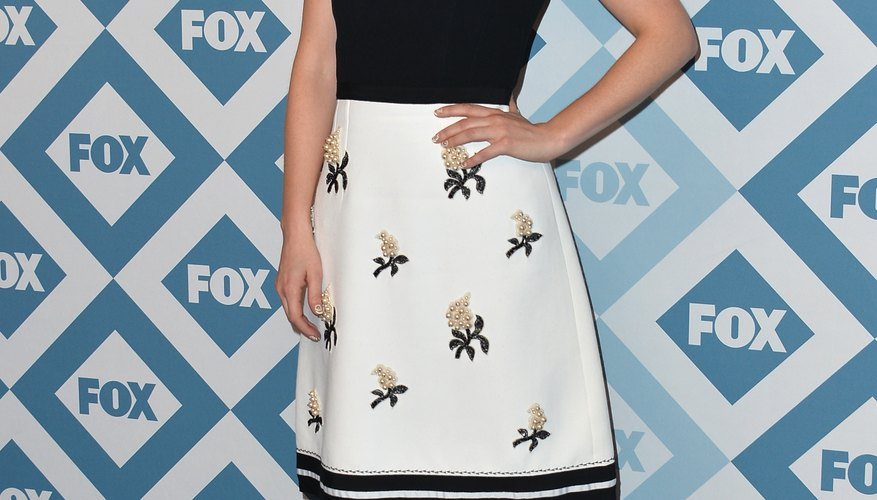 Known for her vintage style, actress Zooey Deschanel wears black ballet flats at the Fox All-Star event in Pasadena in 2014.