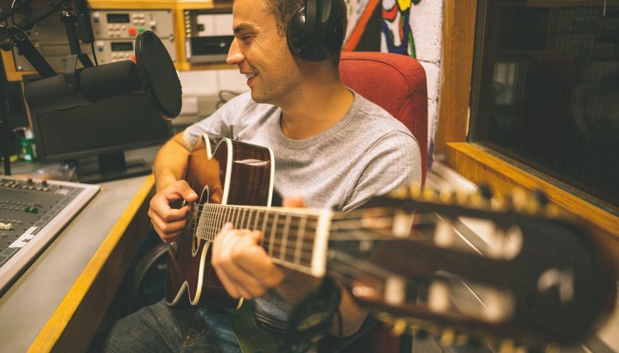 Singer recording and playing guitar