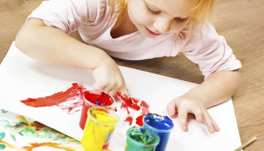 Young girl painting.