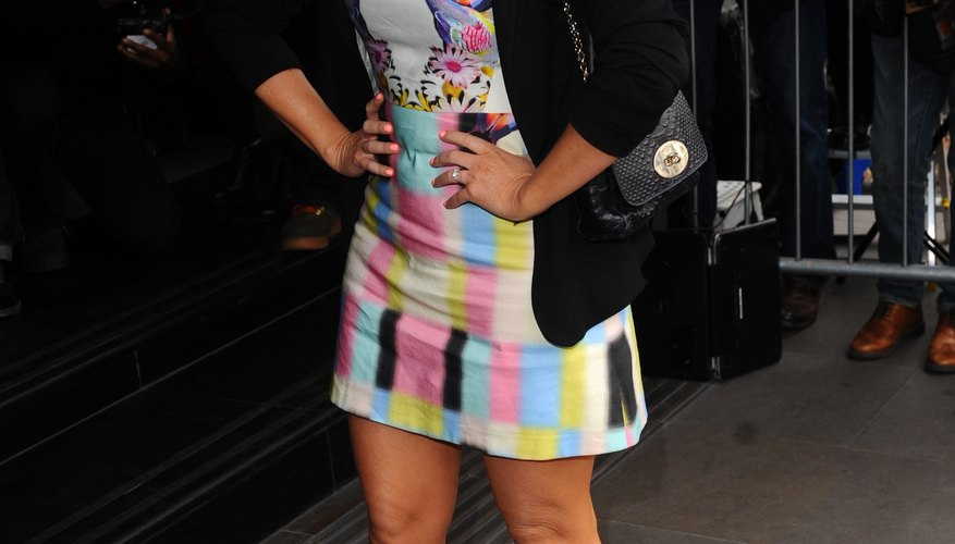 Singer Emma Bunton wears a black boyfriend blazer with a colorful dress at an event in London in 2014.