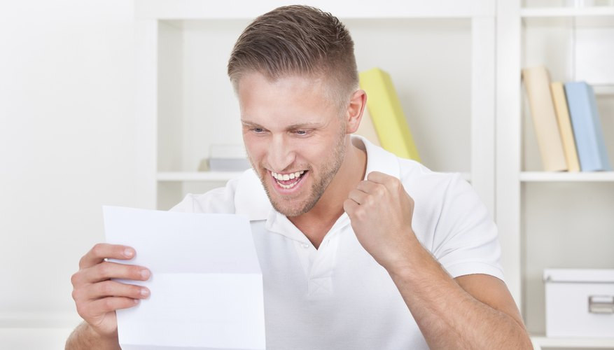 Student reading college letter.
