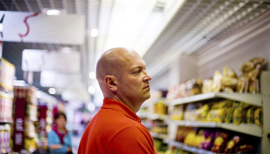 A man is shopping in a grocery store.