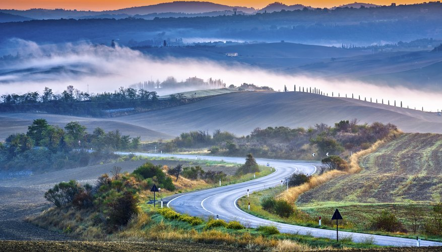 Tuscany foggy landscape at sunrise in Italy
