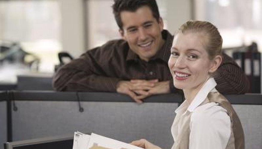 Finding reasons to talk to you at work may mean he's interested.