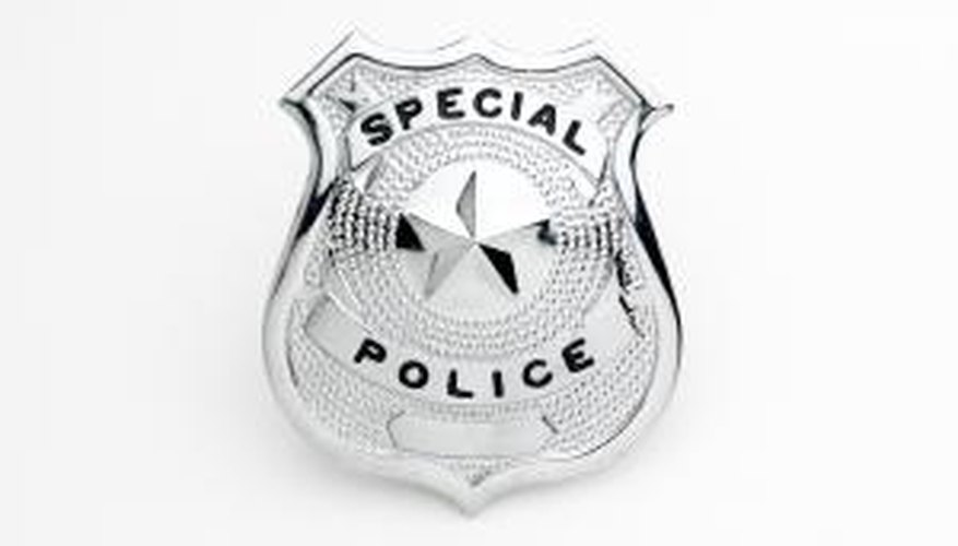 Real badges have the officer's name, department, and badge number listed. Fake badges are generic.
