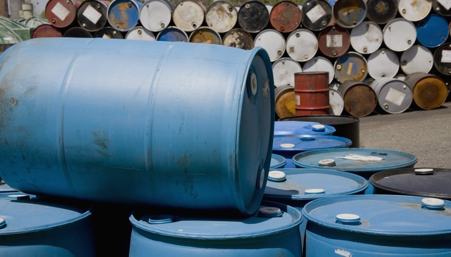 Stacked oil containers.