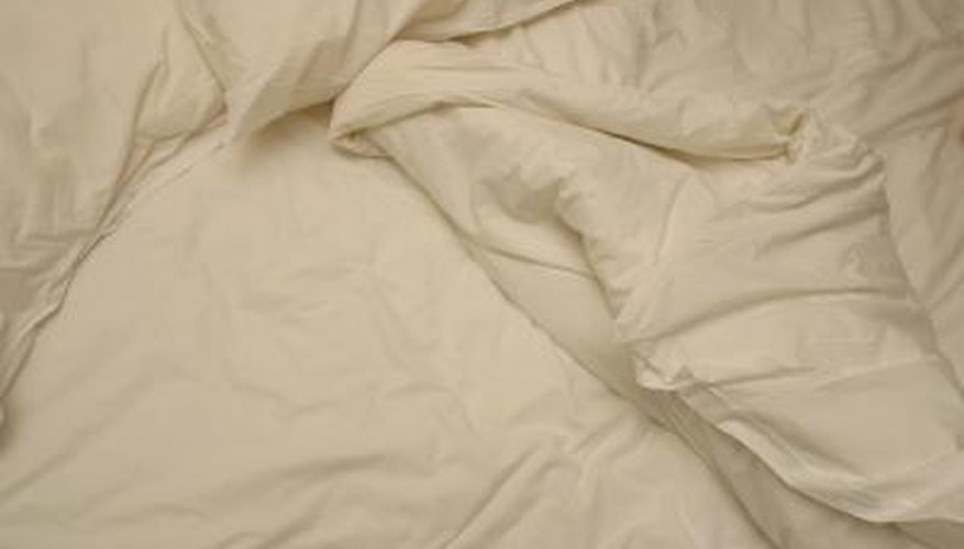 Always inspect bed sheets carefully before you place them into the dryer.