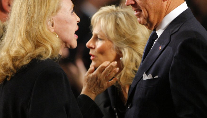 Vice President Biden chats with Sen. Edward Kennedy's ex-wife, Joan, during the Mass for the senator in Washington, D.C.