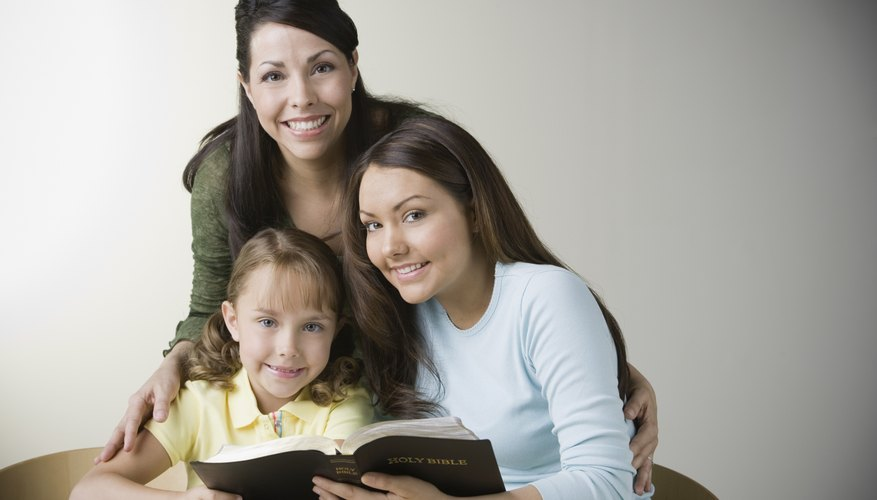 A young child and her teachers are learning the bible.