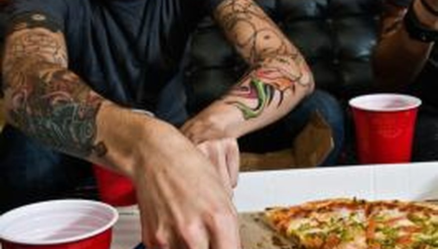 When surrounded by other tattoos, small initial tattoos may blend in.