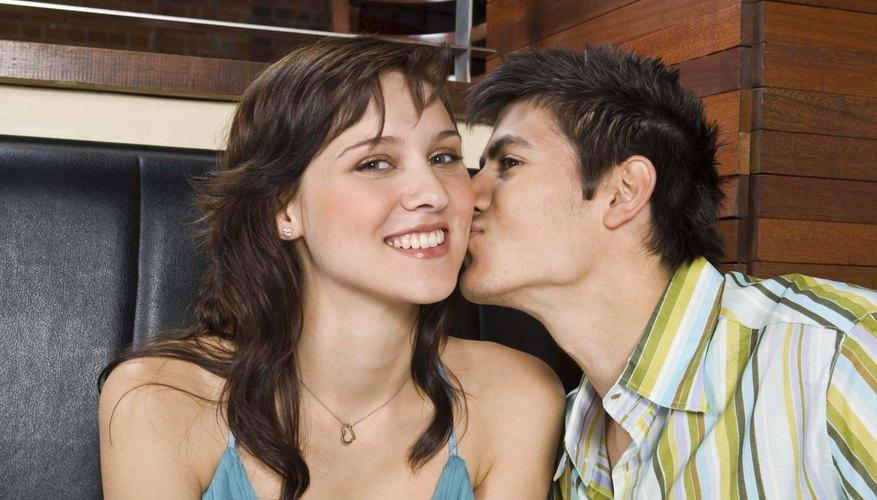 Gemini man kissing woman