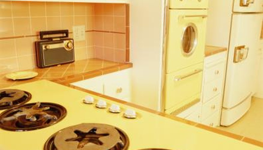 Washing machines and dryers were installed in the kitchens of some homes.