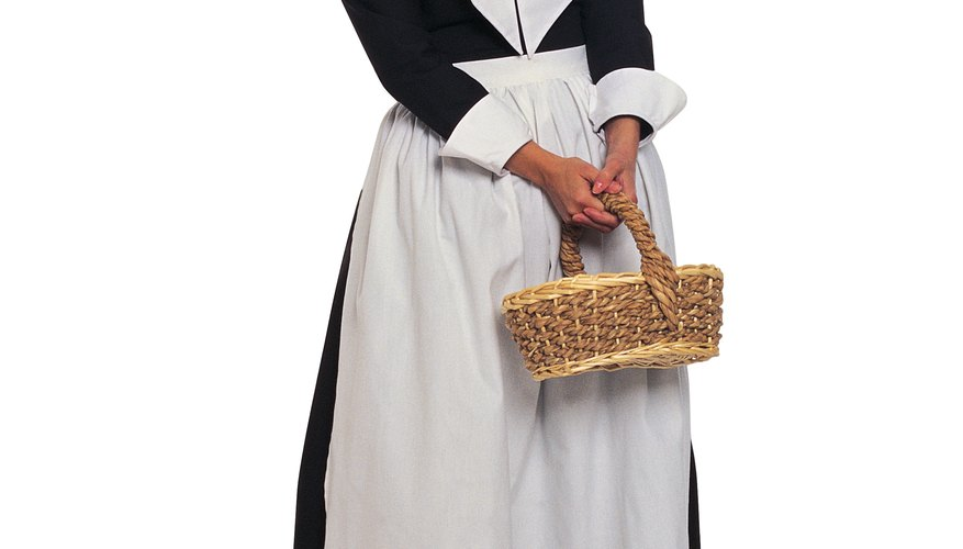 Puritan woman in standard dress.