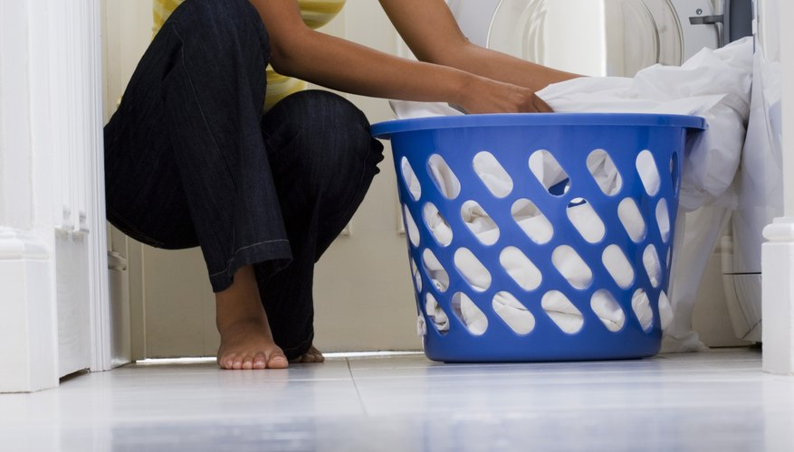 Dry the laundry only after stains are completely removed.
