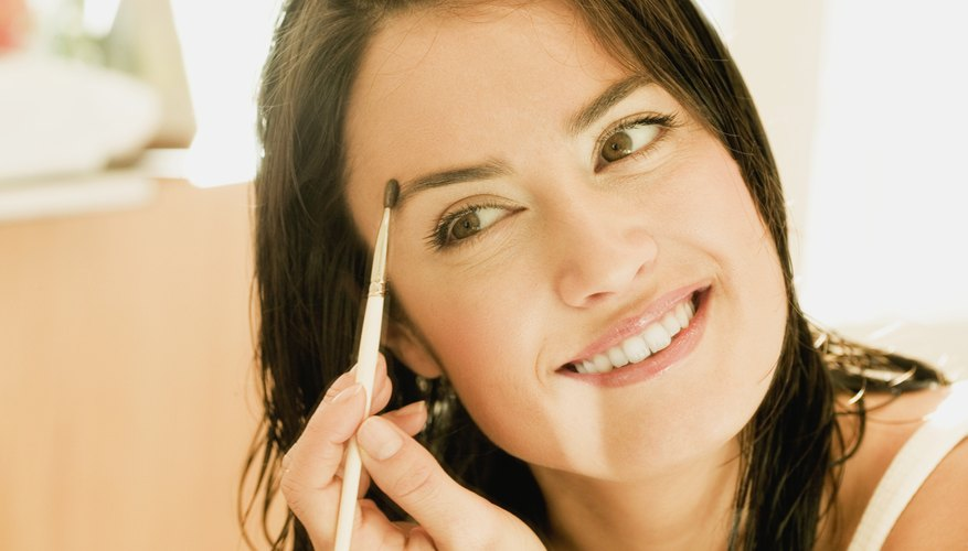 Shape and thicken eyebrows to highlight facial features.