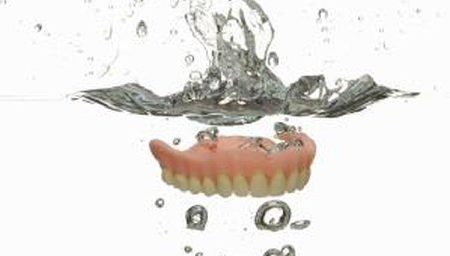Soak dentures to help loosen the gum.