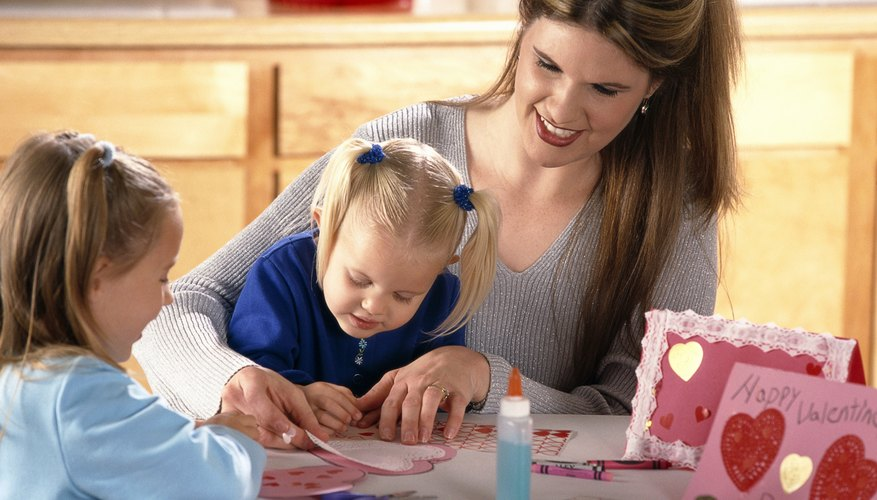 Cut heart shapes in advance for your toddler to make Valentines.