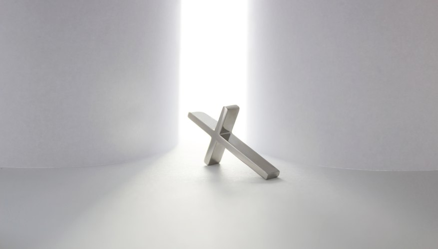 Cross laying in front of bright light.