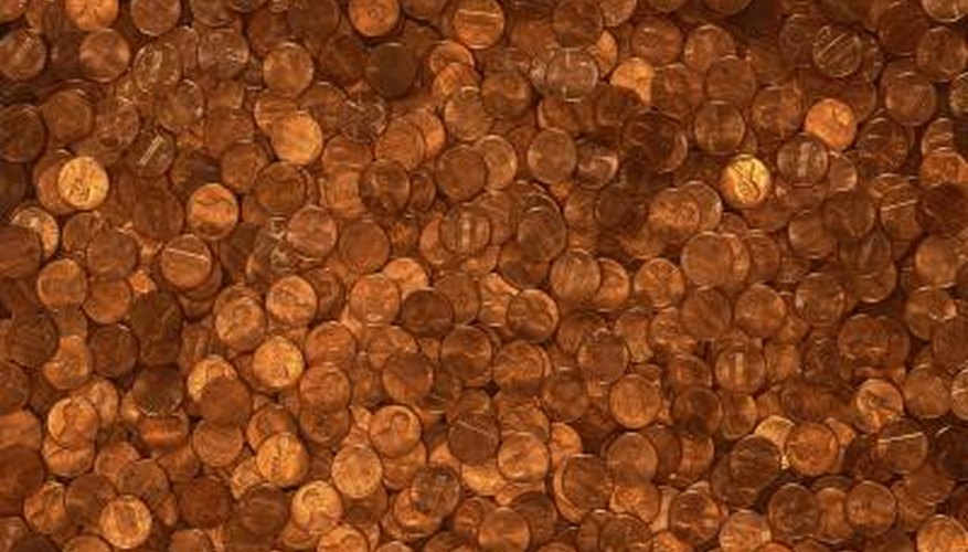 Some pennies look dirty from copper oxide that forms on their surfaces.