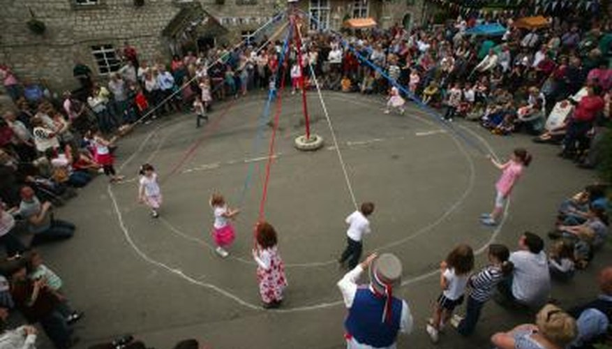 Dancing around a maypole is a popular May Day activity.