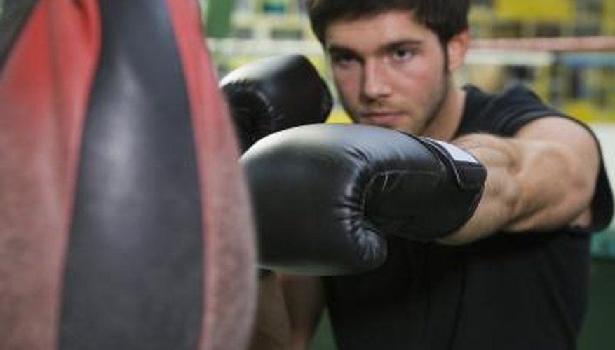 When using boxing punch machines, players strike a hanging speed bag.