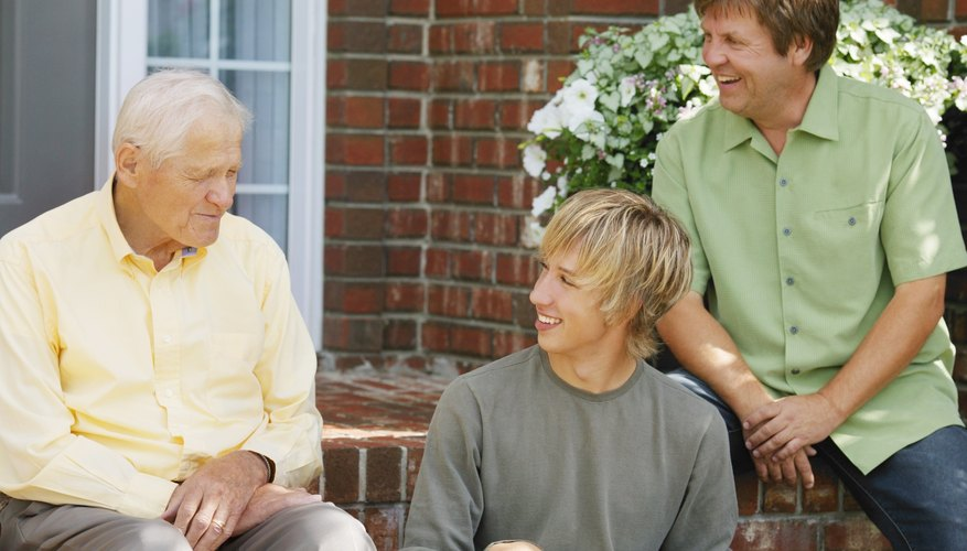 Young man talking to father and grandfather