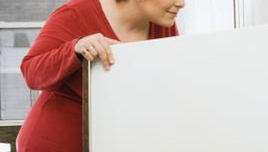 Investigate the cause of chemical odours in a refrigerator as soon as possible.