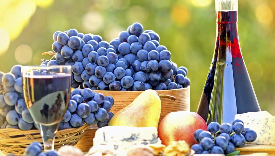 Classic Roman banquet foods include cheeses and grapes.