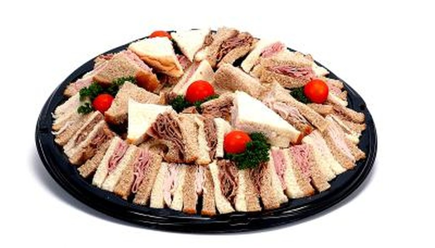 Arrange sandwiches cut in quarters with the crust on the tray.