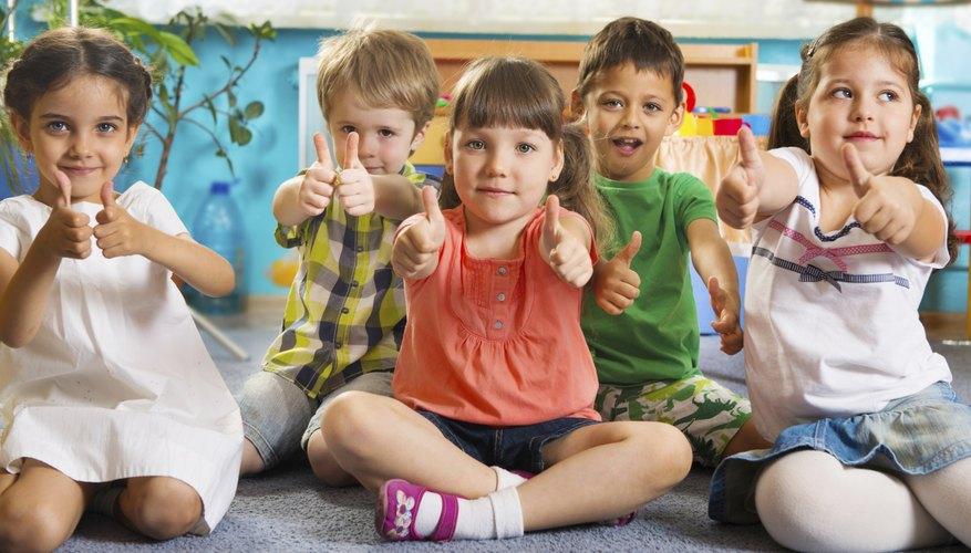 Kindergarteners giving thumbs-up in classroom