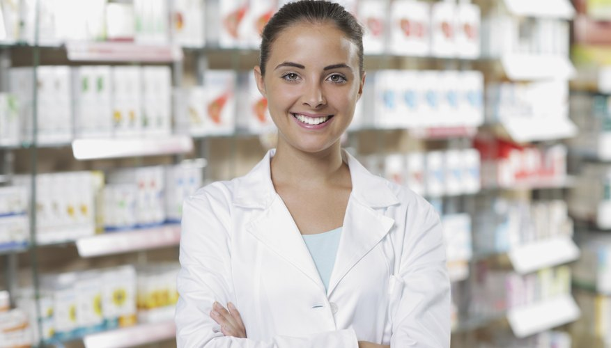 A pharmacist standing in front of medication shelves