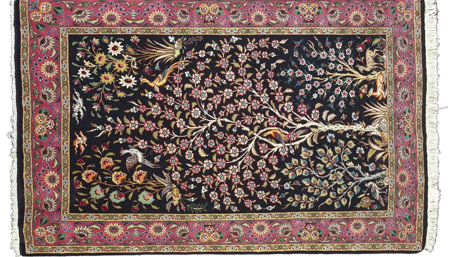 A Mughal carpet with naturalistic vegetal patterns and mille-fleur design.