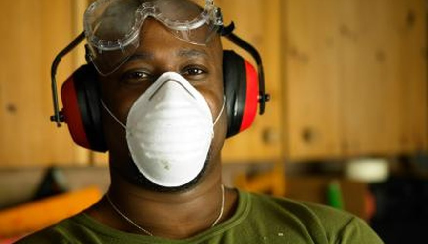 Full protective wear prevents against contact with harmful Corian dust.